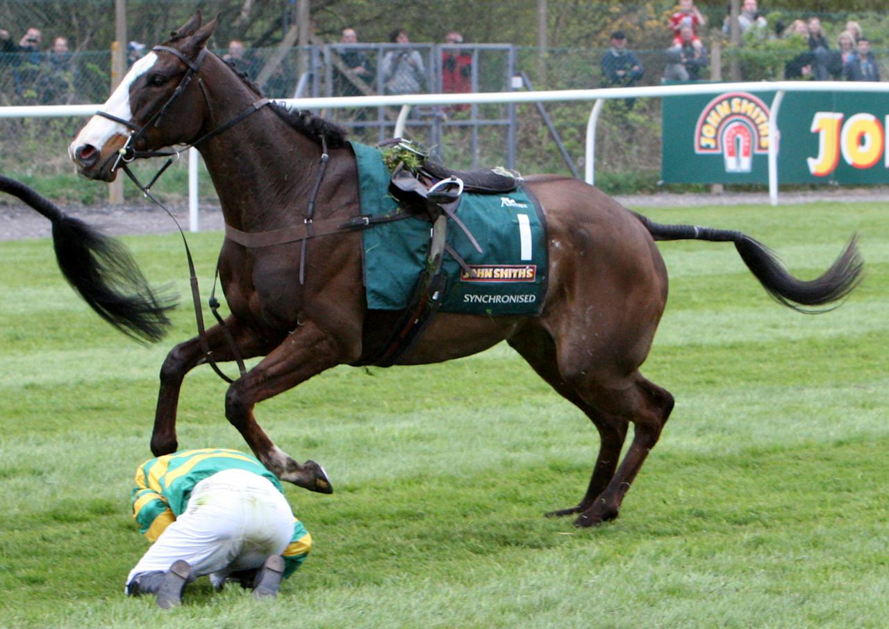 AP McCoy falls from Synchronized at Becher's Brook during the Grand National horse race at Aintree Racecourse, Liverpool, England, Saturday April 14, 2012. (AP Photo/Scott Heppell)
