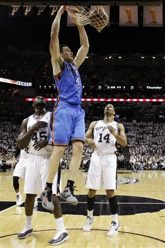 Oklahoma City Thunder power forward Nick Collison (4) dunks against San Antonio Spurs forward DeJuan Blair (45) and point guard Gary Neal (14) during the first half of Game 5 in the NBA basketball Western Conference finals, Monday, June 4, 2012, in San Antonio. (AP Photo/Eric Gay)