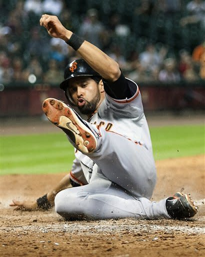 San Francisco Giants' Angel Pagan (16) scores during the fifth inning against the Houston Astros in a baseball game, Thursday, Aug. 30, 2012, in Houston Texas. (AP Photo/Patric Schneider)