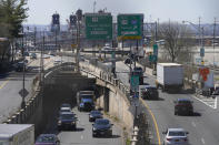 """Cars maneuver through tangle of expressways in Jersey City, N.J., Tuesday, April 6, 2021. President Joe Biden is setting about convincing America it needs his $2.3 trillion infrastructure plan, deputizing a five-member """"jobs Cabinet"""" to help in the effort. But the enormity of his task is clear after Senate Minority Leader Mitch McConnell's vowed to oppose the plan """"every step of the way."""" (AP Photo/Seth Wenig)"""