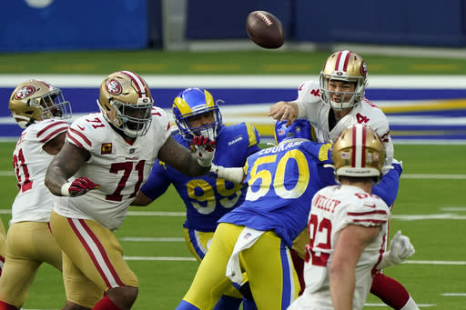 San Francisco 49ers quarterback Nick Mullens (4) throws under pressure during the first half of an NFL football game against the Los Angeles Rams Sunday, Nov. 29, 2020, in Inglewood, Calif. (AP Photo/Alex Gallardo)
