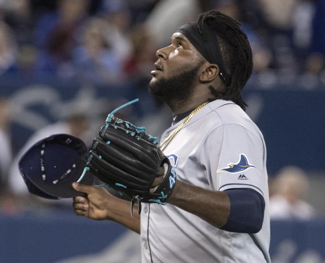 Tampa Bay Rays pitcher Diego Castillo reacts after striking out Toronto Blue Jays' Luke Maile in the eighth inning of a baseball game Friday, April 12, 2019, in Toronto. (Fred Thornhill/The Canadian Press via AP)