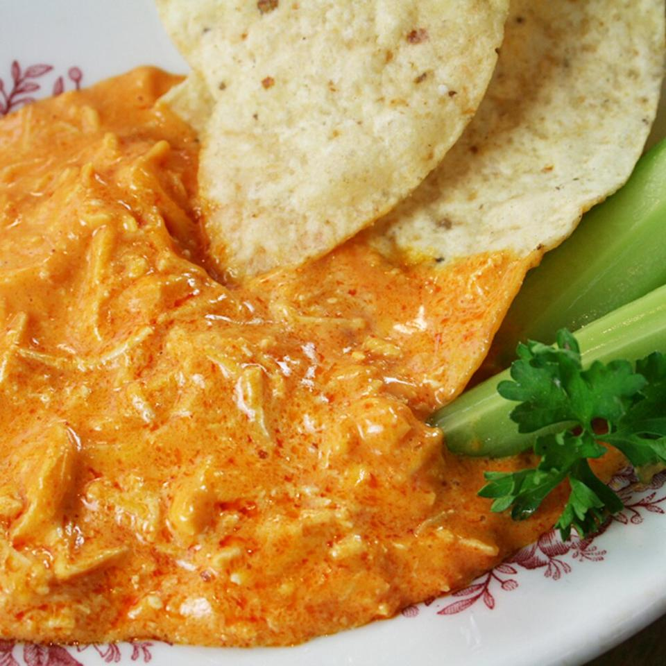 """<p>This easy buffalo chicken dip is addictively delicious, and you'll never bring it to a party without getting rave reviews. Our buffalo chicken dip recipe delivers bold, three-cheese flavors and a kick of spice from the hot sauce. The creamy, tangy dip is the perfect crowd-friendly comfort food to make as temperatures drop. Serve this 5-ingredient dip with crackers and celery, and keep this appetizer in your collection of easy tailgating or dinner party favorites.</p> <p><a href=""""https://www.myrecipes.com/recipe/buffalo-chicken-dip"""">Buffalo Chicken Dip Recipe</a></p>"""