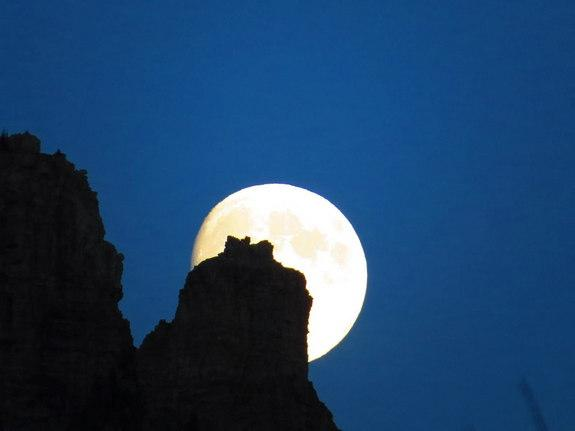 Sky watcher Austin Moloughney sent in a photo of the moon rising behind Vimy Mountain, Alberta, Canada, on August 18, 2013.