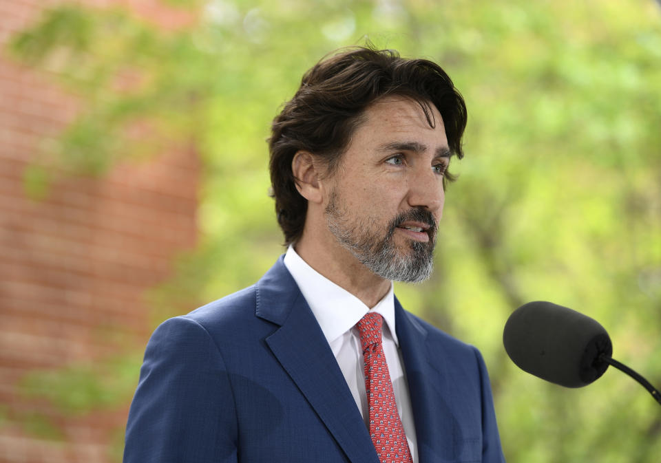 """FILE - In this May 19, 2020, file photo, Canadian Prime Minister Justin Trudeau speaks during his daily news conference on the COVID-19 pandemic outside his residence at Rideau Cottage in Ottawa, Ontario. Trudeau said Tuesday, June 2, that Canadians are watching what's unfolding in the United States with """"horror and consternation"""" and he paused for 21 seconds when asked about U.S. (Justin Tang/The Canadian Press via AP, File)"""