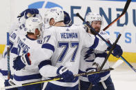Tampa Bay Lightning right wing Nikita Kucherov (86) celebrates his first of two goal during the second period against the Florida Panthers in Game 1 of an NHL hockey Stanley Cup first-round playoff series, Sunday, May 16, 2021, in Sunrise, Fla. (AP Photo/Joel Auerbach)