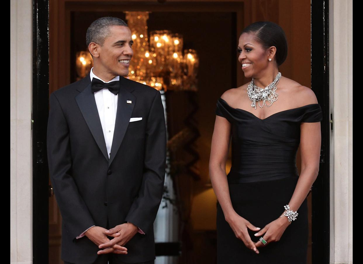 LONDON, ENGLAND - MAY 25: U.S. President Barack Obama and First Lady Michelle Obama arrive at Winfield House, the residence of the Ambassador of the United States of America, in Regent's Park, on May 25, 2011 in London, England. The 44th President of the United States, Barack Obama, and First Lady Michelle are in the UK for a two day State Visit at the invitation of HM Queen Elizabeth II. Last night they attended a state banquet at Buckingham Palace and today's events include talks at Downing Street and the President will address both houses of Parliament at Westminster Hall. (Photo by Yui Mok - WPA Pool/Getty Images)