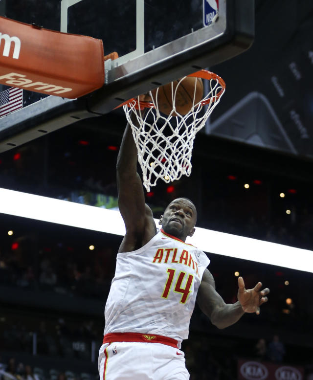 Atlanta Hawks center Dewayne Dedmon (14) scores during the first half of an NBA basketball game against the Sacramento Kings Wednesday, Nov. 15, 2017, in Atlanta. (AP Photo/John Bazemore)