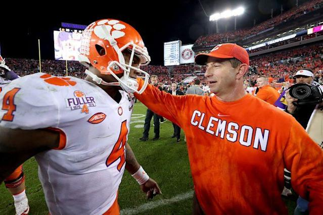 Clemson quarterback Deshaun Watson and coach Dabo Swinney celebrate after winning the national title. (Getty Images)