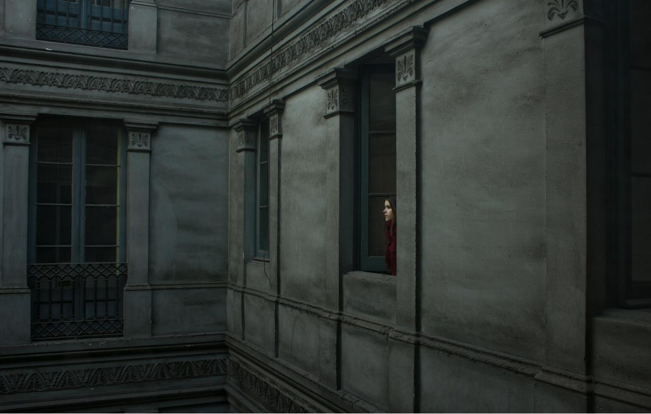 Youth 'Portraits' winner: Berta Vicente, Spain. A girl in red looks out of a dark building in 'Ariadna in Urquinaona' (Berta Vicente, Spain, Winner, Portraits, Youth Competition, 2013 Sony World Photography Awards)