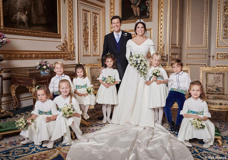 The newlyweds pose with their pages and bridesmaids. Prince George smiles in the back row with his sister, Princess Charlotte. Brooksbank rests his hand on the shoulder of Theodora Williams, daughter of singer Robbie Williams and Ayda Field. (Photo: Alex Bramall/Courtesy Buckingham Palace)