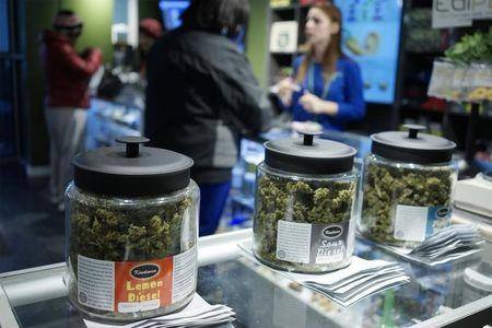 """Customers shop for """"Green Friday"""" deals at the Grass Station marijuana shop on Black Friday in Denver"""