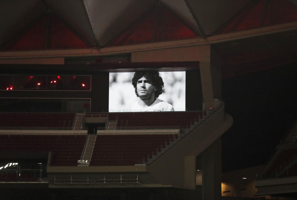 A picture of soccer legend Diego Maradona is see on the screen of the Wanda Metropolitano stadium in Madrid, Spain, prior to the Champions League group A soccer match between Atletico Madrid and Lokomotiv Moscow at Wednesday, Nov. 25, 2020. Maradona died Wednesday at the age of 60. (AP Photo/Manu Fernandez)