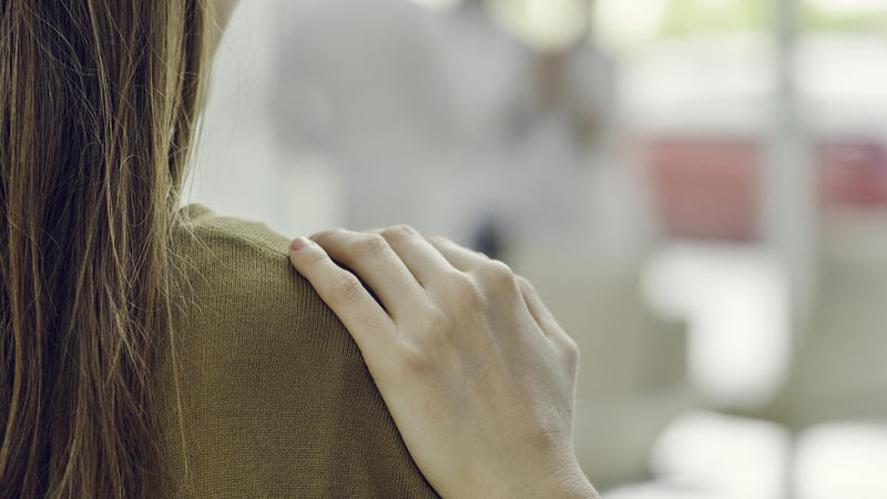 Hand on shoulder represents 'are you ok' mental health conversation