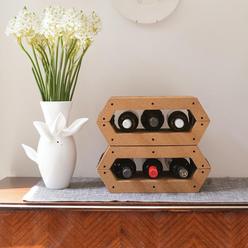 """<h2>Como Wine Rack</h2><br>For a wine rack that, quite literally, does it all, she'll love this adaptable option that can also be a bedside table, a bookshelf, a storage box, or support for her laptop. <br><br><em>Shop <strong><a href=""""https://www.iamfy.co/product/small-como-twist-module"""" rel=""""nofollow noopener"""" target=""""_blank"""" data-ylk=""""slk:Fy!"""" class=""""link rapid-noclick-resp"""">Fy!</a></strong></em><br><br><strong>Como</strong> Wine Rack, $, available at <a href=""""https://go.skimresources.com/?id=30283X879131&url=https%3A%2F%2Fwww.iamfy.co%2Fproduct%2Fsmall-como-twist-module"""" rel=""""nofollow noopener"""" target=""""_blank"""" data-ylk=""""slk:Fy!"""" class=""""link rapid-noclick-resp"""">Fy!</a>"""