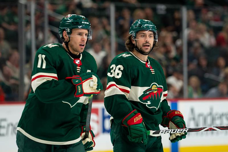 Minnesota Wild forward Mats Zuccarello (36) and forward Zach Parise (11)