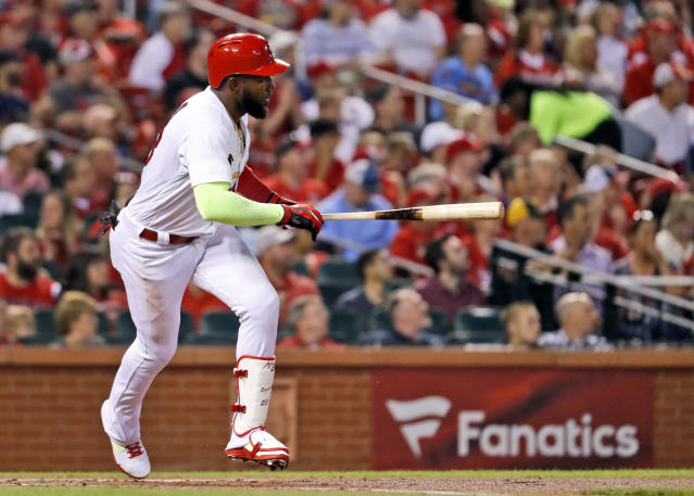St. Louis Cardinals' Marcell Ozuna watches his two-run double during the first inning of a baseball game against the Pittsburgh Pirates, Tuesday, Sept. 11, 2018, in St. Louis. (AP Photo/Jeff Roberson)