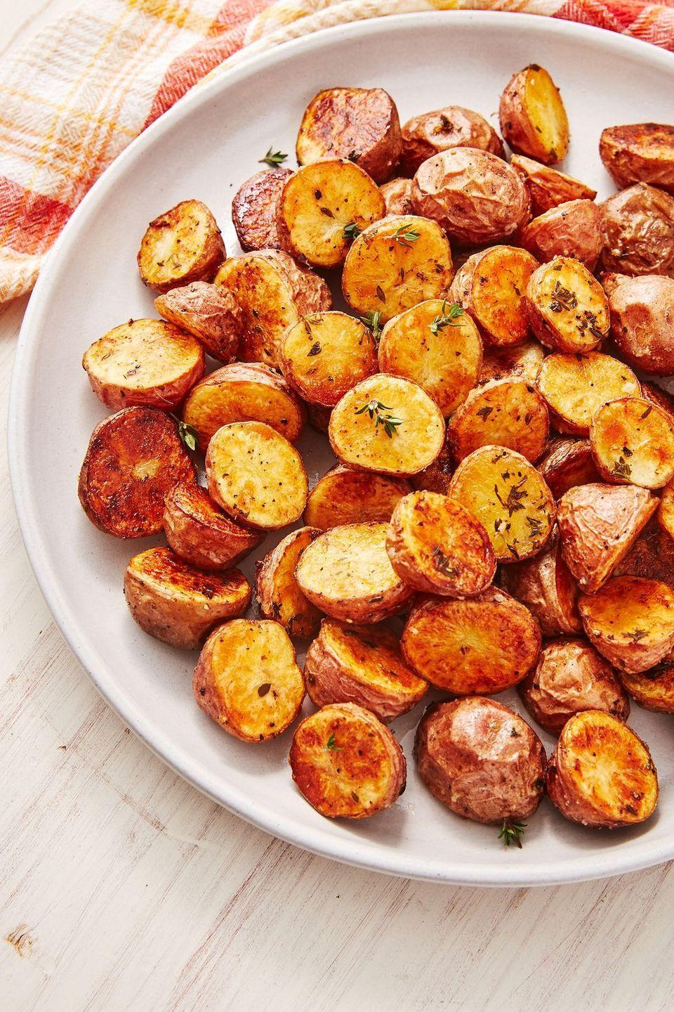 """<p>Perfectly golden and crisp <a href=""""https://www.delish.com/uk/cooking/recipes/a30438329/potato-salad/"""" rel=""""nofollow noopener"""" target=""""_blank"""" data-ylk=""""slk:potatoes"""" class=""""link rapid-noclick-resp"""">potatoes</a> are very achievable. <a href=""""https://www.delish.com/uk/food-news/a29456647/how-to-cook-roast-potatoes/"""" rel=""""nofollow noopener"""" target=""""_blank"""" data-ylk=""""slk:Roasting your potatoes"""" class=""""link rapid-noclick-resp"""">Roasting your potatoes</a> at a high temp and making sure your potatoes are cut side down are the magic tricks. It takes an extra minute to arrange all of them but the results are very much well worth it. Be sure to not overcrowd your pan and roast in batches if necessary!</p><p>Get the <a href=""""https://www.delish.com/uk/cooking/recipes/a32681763/roasted-red-potatoes-recipe/"""" rel=""""nofollow noopener"""" target=""""_blank"""" data-ylk=""""slk:Roasted Red Potatoes"""" class=""""link rapid-noclick-resp"""">Roasted Red Potatoes</a> recipe.</p>"""