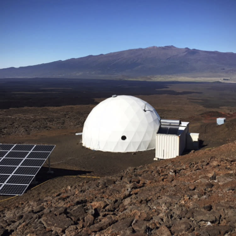 In this photo provided by the University of Hawaii, six carefully selected scientists entered this geodesic dome called Hawaii Space Exploration Analog and Simulation, or HI-SEAS located 8,200 feet above sea level on Mauna Loa on the island of Hawaii, Thursday, Jan. 19, 2017. The four men and two women moved into their new simulated space home Thursday afternoon, as part of a human-behavior study that could help NASA as it draws up plans for sending astronauts on long missions to Mars. (University of Hawaii via AP)