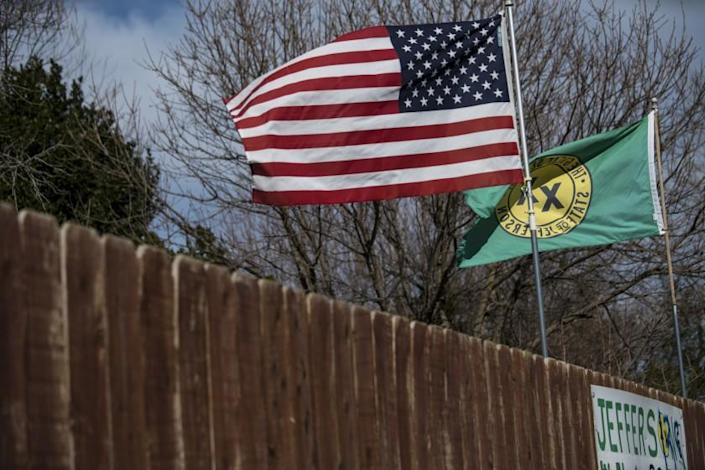 """Flags of the United States and the """"State of Jefferson"""" are seen flying in Anderson, California"""