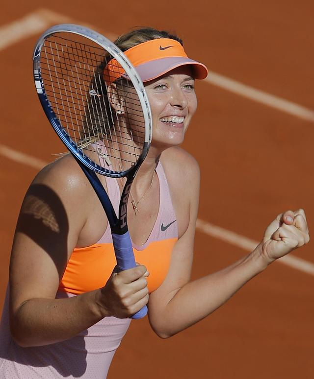 Russia's Maria Sharapova celebrates winning the semifinal match of the French Open tennis tournament against Canada's Eugenie Bouchard at the Roland Garros stadium, in Paris, France, Thursday, June 5, 2014. Sharapova won in three sets 4-6, 7-5, 6-2. (AP Photo/Michel Spingler)