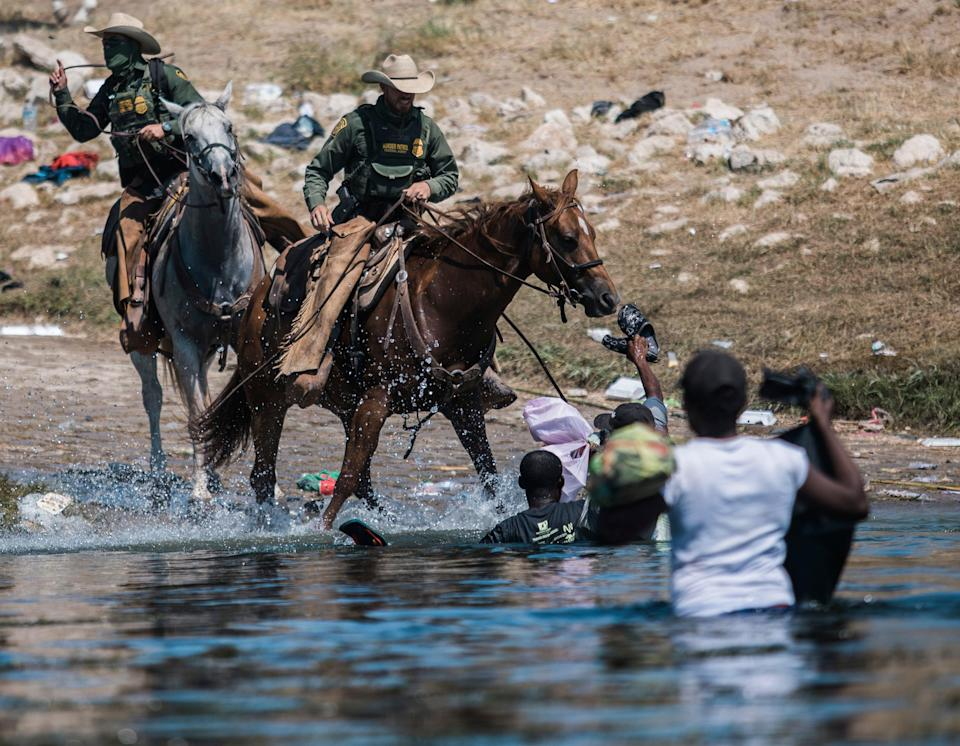 Haitian migrants are confronted by Customs and Border Protection agents in Del Rio, Texas  (Copyright 2021 The Associated Press. All rights reserved)