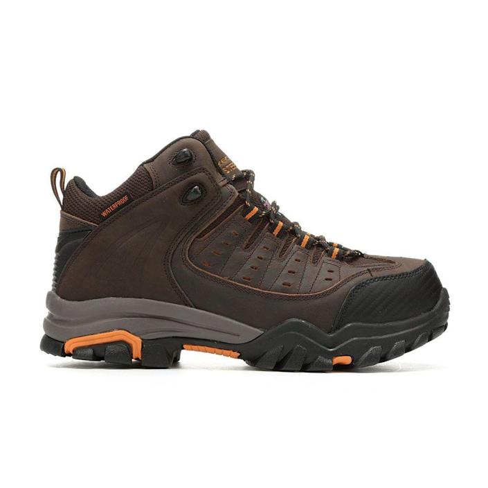 """<p><strong>Skechers</strong></p><p>shoecarnival.com</p><p><a href=""""https://go.redirectingat.com?id=74968X1596630&url=https%3A%2F%2Fwww.shoecarnival.com%2Fmens_skechers_work_lakehead_waterproof_steel_toe_77126_work_boots%2F67-1682391.html%3Fgclid%3DCj0KCQjw8rT8BRCbARIsALWiOvR9CE7h9A3tZVOz18WtF3r7PtavWwSmCwWaeQ9eW4_6HKEbtOMqxmQaAsahEALw_wcB%26gclsrc%3Daw.ds%26ocid%3DPS-GGL-PLA-94837&sref=https%3A%2F%2Fwww.menshealth.com%2Fstyle%2Fg19540212%2Fwork-boots-for-men%2F"""" rel=""""nofollow noopener"""" target=""""_blank"""" data-ylk=""""slk:BUY IT HERE"""" class=""""link rapid-noclick-resp"""">BUY IT HERE</a></p><p><del>$104.99</del><strong><br>$99.98</strong></p><p>If you prefer an ankle-height work boot, look no further than this pair from Skechers. They boast the same features as their taller counterparts, like a steel toe and slip-resistant and oil-resistant rubber traction outsoles, but less height means they're a little lighter for stomping around the work site. The memory foam insole is designed to keep your feet refreshed enough to tackle another day.</p>"""
