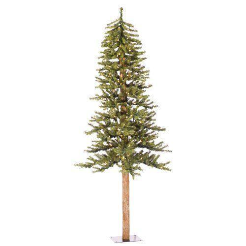"""<p><strong>Vickerman</strong></p><p>amazon.com</p><p><strong>$93.01</strong></p><p><a href=""""https://www.amazon.com/dp/B004DARBZA?tag=syn-yahoo-20&ascsubtag=%5Bartid%7C10050.g.5027%5Bsrc%7Cyahoo-us"""" rel=""""nofollow noopener"""" target=""""_blank"""" data-ylk=""""slk:Shop Now"""" class=""""link rapid-noclick-resp"""">Shop Now</a></p><p>The Alpine tree boasts a long stump that is perfect for nestling into a tiny corner. </p>"""