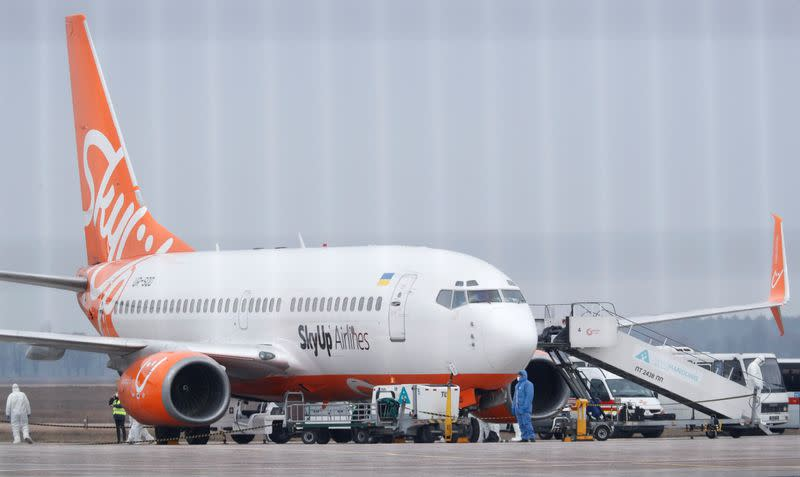 An aircraft transporting passengers from China is seen at an airport outside Kiev