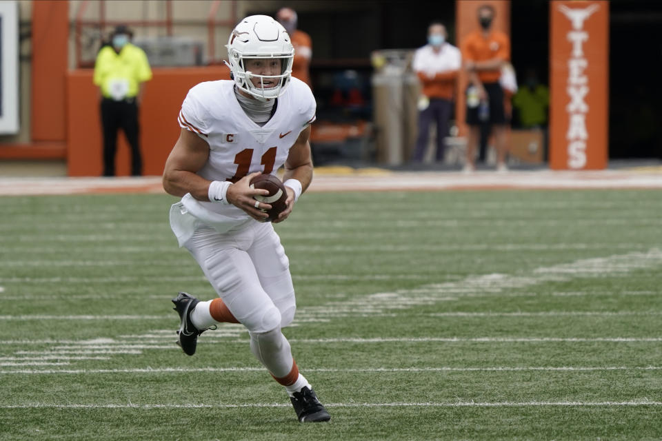 Texas QB Sam Ehlinger will be a tricky evaluation for some NFL teams. (AP Photo/Chuck Burton)