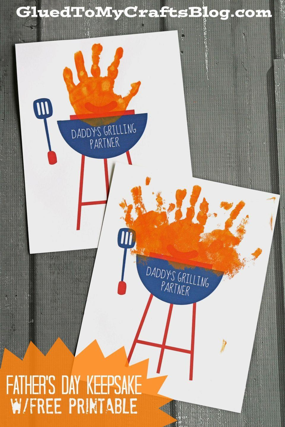 """<p>Make copies of this <a href=""""http://gluedtomycraftsblog.com/2016/05/daddys-grilling-partner-keepsake-wfree-printable.html/daddys-grilling-partner-2"""" rel=""""nofollow noopener"""" target=""""_blank"""" data-ylk=""""slk:free grill-themed printable"""" class=""""link rapid-noclick-resp"""">free grill-themed printable</a>, then have the kids dip their hands in paint to create """"flames.""""</p><p><strong><em>Get the tutorial at <a href=""""http://gluedtomycraftsblog.com/2016/05/daddys-grilling-partner-keepsake-wfree-printable.html/daddys-grilling-partner-2"""" rel=""""nofollow noopener"""" target=""""_blank"""" data-ylk=""""slk:Glued to My Crafts"""" class=""""link rapid-noclick-resp"""">Glued to My Crafts</a>.</em></strong></p>"""