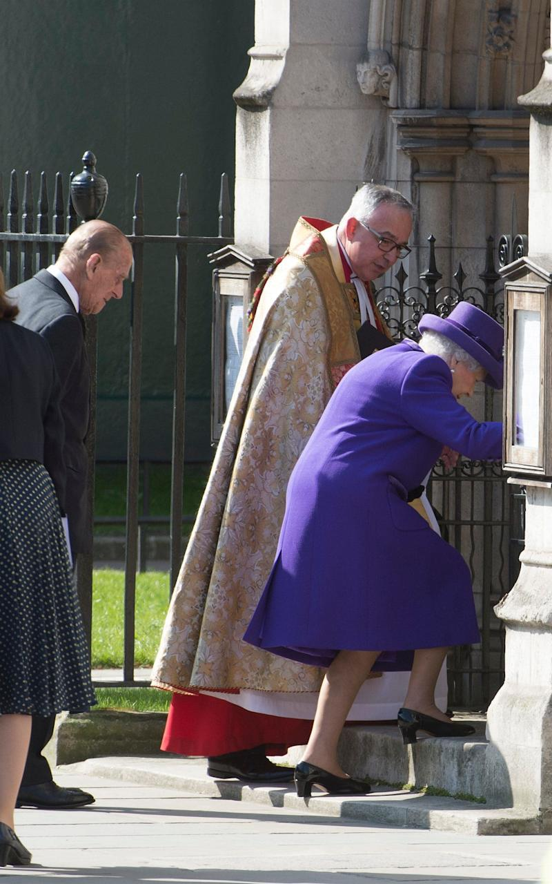 The Queen stumbles on the steps as she arrives at St Margaret's Church in Westminster for the Thanksgiving Service for Lord Snowdon - Credit: Julian Simmonds/The Telegraph