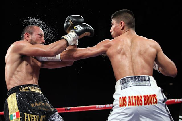 Mikey Garcia (R) in action against WBO featherweight champion Orlando Salido on Jan. 19, 2013, in New York. Garcia won the title via technical decision in the eighth round after an accidental head butt broke Garcia's nose. (AP Photo/Gregory Payan)