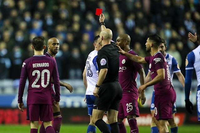 "<a class=""link rapid-noclick-resp"" href=""/soccer/players/fabian-delph/"" data-ylk=""slk:Fabian Delph"">Fabian Delph</a> was shown a late-first-half red card, and <a class=""link rapid-noclick-resp"" href=""/soccer/teams/manchester-city/"" data-ylk=""slk:Manchester City"">Manchester City</a> went on to lose in the FA Cup to Wigan. (Getty)"