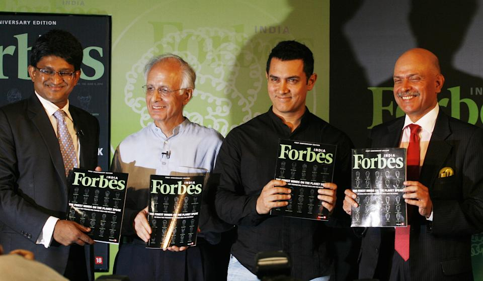MUMBAI, INDIA - MAY 20: (l to r) Sendhil Chengalvarayan, president and editorial director, TV18, Arun Maira, member of India's planning commission, Bollywood actor Aamir Khan, and Raghav Bahl, founder editor of Network 18, display copies of Forbes India's first anniversary special issue during it's launch on May 20, 2010 in Mumbai, India. (Photo by Solaris Images/Getty Images)