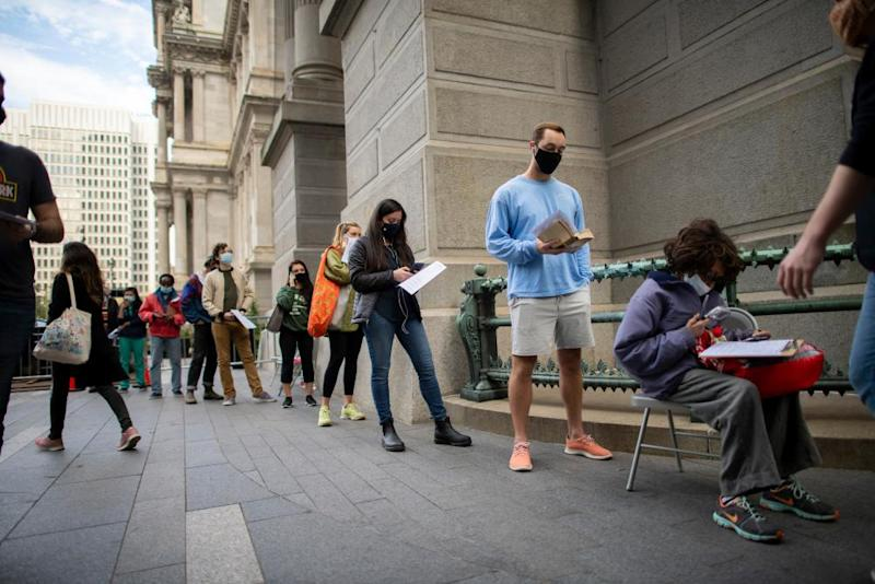 Voters wait in line outside of city hall in Philadelphia, Pennsylvania, on 27 October.