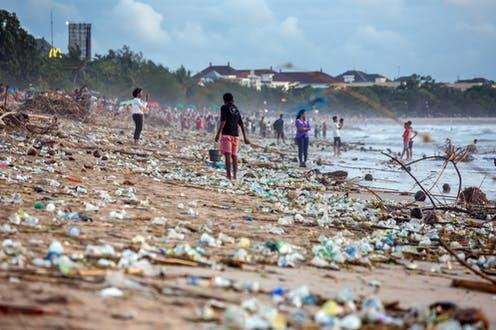 """<span class=""""caption"""">Plastic waste is the most visible component of ocean pollution.</span> <span class=""""attribution""""><a class=""""link rapid-noclick-resp"""" href=""""https://www.shutterstock.com/image-photo/bali-indonesia-february-12-2017-beach-1036531933"""" rel=""""nofollow noopener"""" target=""""_blank"""" data-ylk=""""slk:Maxim Blinkov/Shutterstock"""">Maxim Blinkov/Shutterstock</a></span>"""