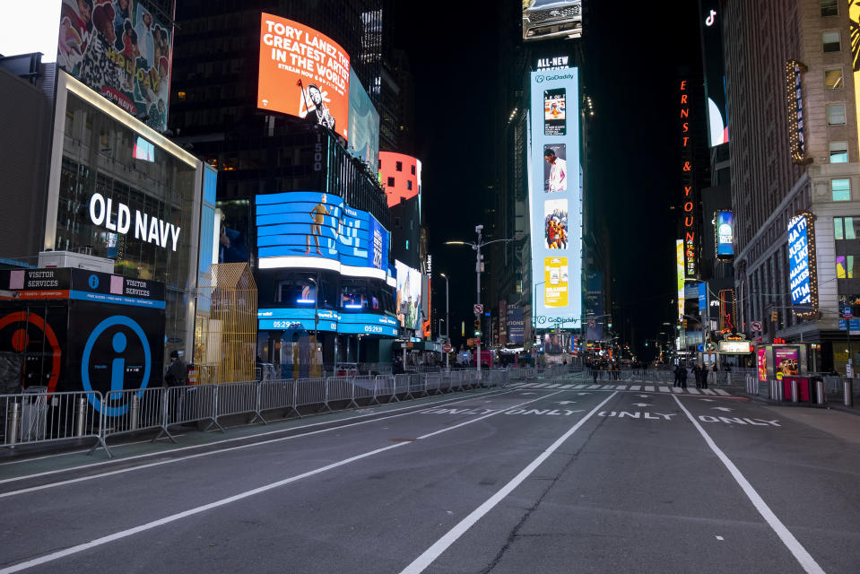 Seventh Avenue is mostly empty during what would normally be a Times Square packed with people, late Thursday, Dec. 31, 2020, in New York, as celebrations have been truncated this New Year's Eve due to the ongoing pandemic. (AP Photo/Craig Ruttle)