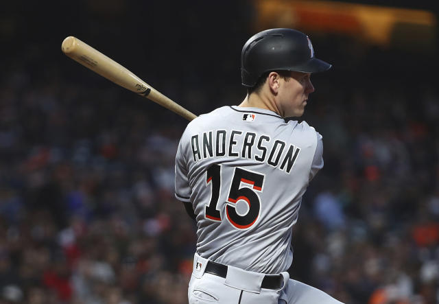 Miami Marlins' Brian Anderson follows through on an RBI double off San Francisco Giants' Dereck Rodriguez during the fourth inning of a baseball game Tuesday, June 19, 2018, in San Francisco. (AP Photo/Ben Margot)