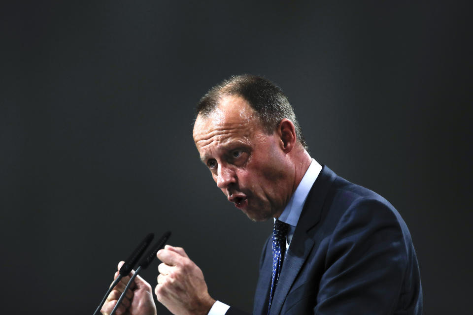 FILE - In this Friday, Dec. 7, 2018. File photo, Friedrich Merz party member and candidate for the Christian Democratic Union, CDU, party chairmanship delivers his speech during a party convention in Hamburg, Germany. German Chancellor Angela Merkel's center-right party, the Christian Democratic Union, CDU, is choosing a new leader on the weekend Saturday Jan. 16 and Sunday Jan. 17, 2021, a decision that will help determine who succeeds Merkel at the helm of the European Union's biggest economy after a 16-year reign. (AP Photo/Markus Schreiber, file)