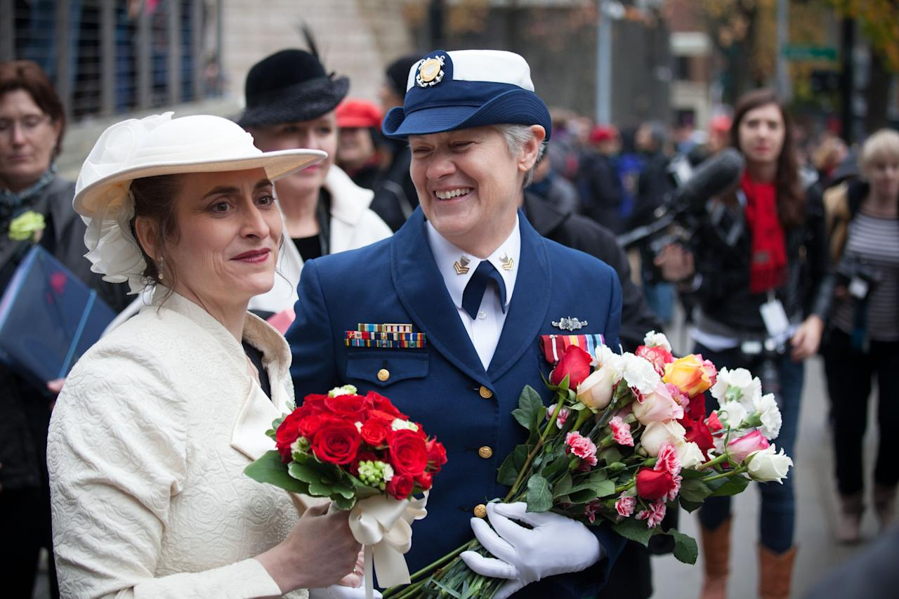 SEATTLE, WA - DECEMBER 9: Nancy Monahan, right, a retired Coast Guard petty officer, shares a laugh with her wife, Deb Needham, after their wedding at City Hall on December 9, 2012 in Seattle, Washington. Today is the first day that same-sex couples can legally wed in Washington state. (Photo by David Ryder/Getty Images)