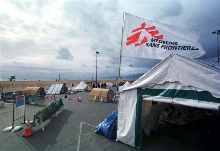 Medecins Sans Frontieres (flag pictured in California in 2000) said that three employees were found dead after the morning after they had lost contact with the medical charity during a trip