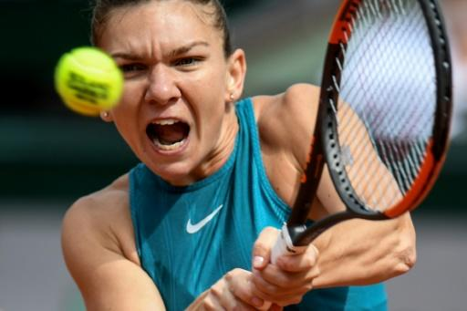 Power-packed: Top seed Simona Halep returns the ball to Belgium's Elise Mertens during their fourth round match on Monday
