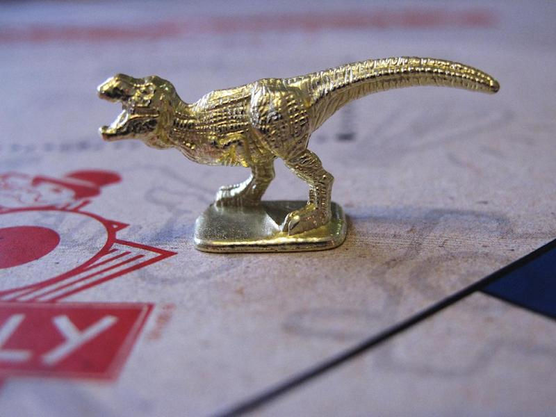 This March 15, 2017 photo shows the T-Rex dinosaur, one of three new tokens that will be included in upcoming versions of the board game Monopoly, in Atlantic City, N.J. Hasbro Inc. revealed the results of voting on Friday, March 17, 2017. Leaving the game will be the boot, wheelbarrow and thimble tokens. (AP Photo/Wayne Parry)