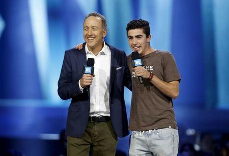 Chief Executive Officer and President of Pacific Sunwear (PacSun) of California Inc. Gary H. Schoenfeld (L) and his son speak on stage during WE Day California in Inglewood, California, April 7, 2016. REUTERS/Danny Moloshok