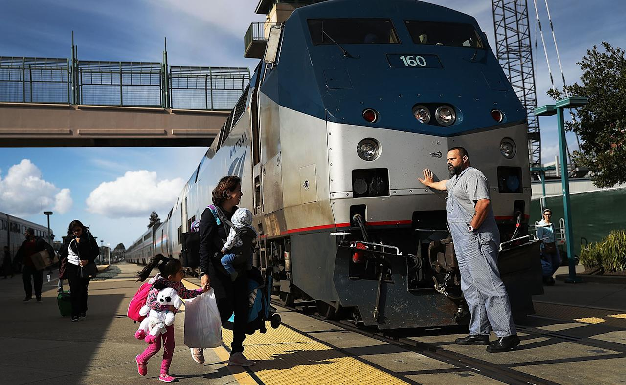 <p>An Amtrak engineer leans on the locomotive as passengers disembark from Amtrak's California Zephyr at the end of its daily 2,438-mile trip to Emeryville/San Francisco from Chicago, whichtook roughly 52 hours, March 25, 2017, in Emeryville, Calif. President Trump has proposed a national budget that would terminate federal support for Amtrak's long distance train services, which would affect the California Zephyr and other long-distance rail lines run by Amtrak. (Photo: Joe Raedle/Getty Images) </p>