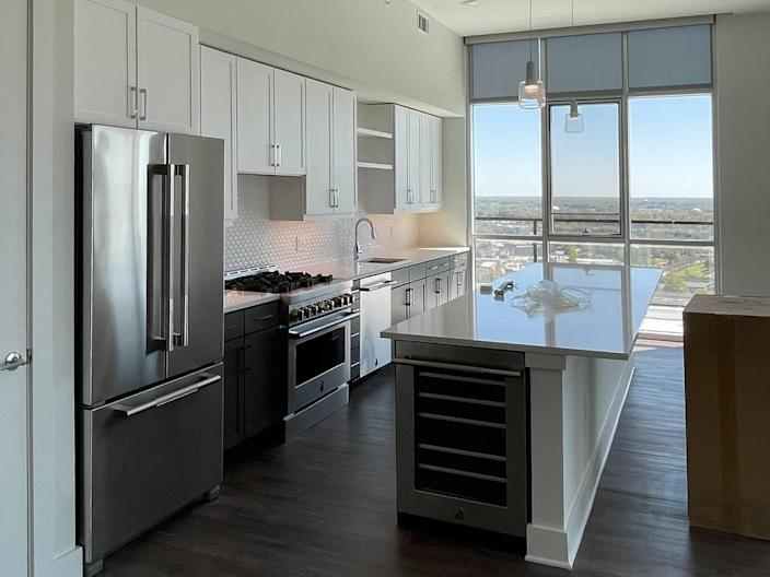 This penthouse kitchen at The Ellis includes upgraded appliances and a view overlooking the city.