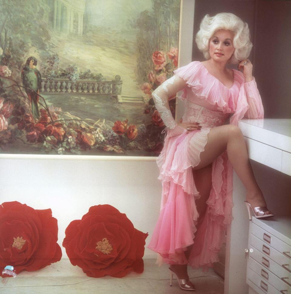"""<p>This now-iconic photo was taken for a cover session at an L.A. studio in 1978 and became the cover of her """"Heartbreaker"""" album featuring the eponymous hit single. Layers of lace and pink chiffon give her a soft look.</p>"""