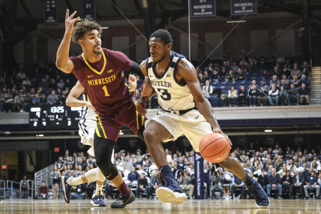 Butler guard Kamar Baldwin (3) drives around Minnesota guard Tre' Williams (1) in the first half of an NCAA college basketball game in Indianapolis, Tuesday, Nov. 12, 2019. (AP Photo/AJ Mast)