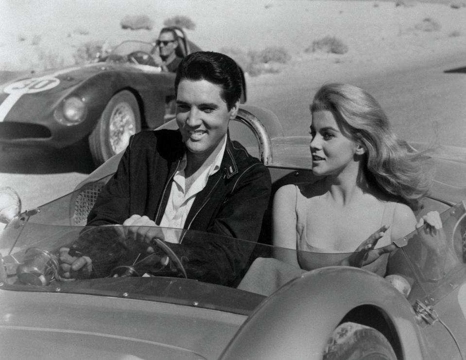 <p>Elvis Presley and Ann-Margret in a scene from the movie Viva Las Vegas. They are driving a stock car. </p>